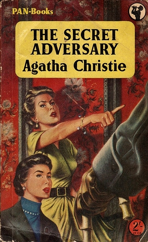 Tuppence with a tidy hairdo and a string of pearls; her companion much more appropriately tousled, considering the revolver covering them both... I'm guessing 1950s for this dramatic paperback jacket.