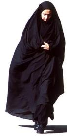 A woman in a chador mixed with modern dress underneath.