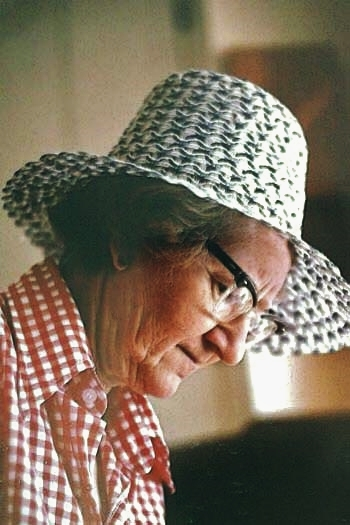 One of my German cousins just sent me this picture. It was taken in the summer of 1981. Mom has just come in from the garden. (I know this because of that distinctive hat; she wore it for years every time she set foot outside between April and October!) She could be shelling peas, or hulling strawberries; that look of concentration and her slight frown is utterly typical. My family tells me I look just the same; our faces share a rather sombre cast which does not necessarily reflect our actually happy mood!