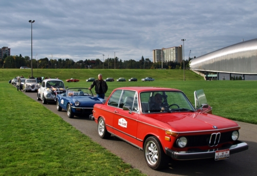 """Start your engines..."" Here we are getting ready to set off on our rally. That's us, the little blue Spitfire hiding between the Beamer and the Bug."