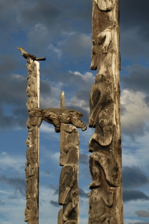 Totem poles near Kitwanga, B.C. These are memorial poles erected over the graves of band chiefs. The figures depict clan memberships and significant connections of the people they memorialize.