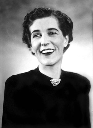 She's smiling! A wonderful and rare photo of Georgette Heyer looking downright happy, her actual state much of the time when not being pinned down by publicity people.